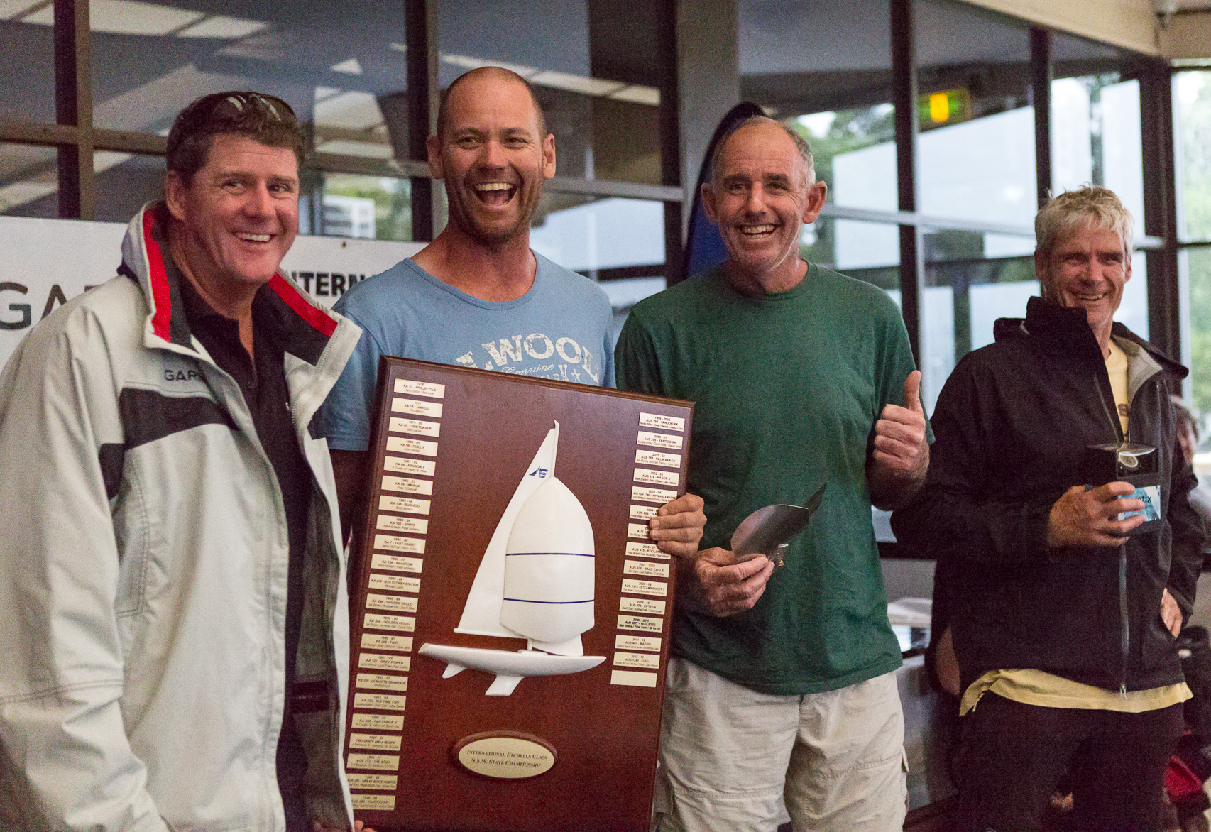 Winners are grinners – none more so than Graeme Taylor, Steve Jarvin and Grant Simmer as Garmin's Jason Browne presented them their loot